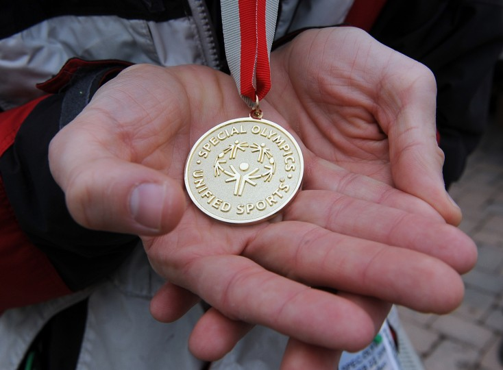 Andy Robillard of Middletown MD holds his gold medal, from the unified advanced slalom event, at the winter 2016 Maryland Special Olympics, which was held at Whitetail Ski Resort.  (Barbara Haddock Taylor/Baltimore Sun)