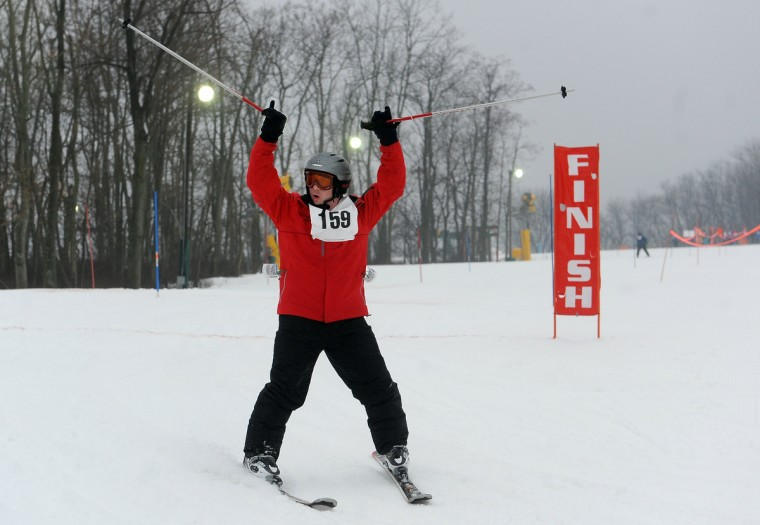 Paul Howard Jr. of Baltimore, who skis with the Carroll county team, raises his arms at the finish line in a slalom event at the winter 2016 Maryland Special Olympics, which was held at Whitetail Ski Resort.  (Barbara Haddock Taylor/Baltimore Sun)