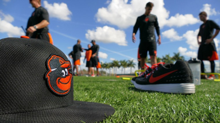 A cap rests while Baltimore Orioles players take a short breather between exercise drills during spring training practice at the Ed Smith Stadium complex. (Karl Merton Ferron/Baltimore Sun)
