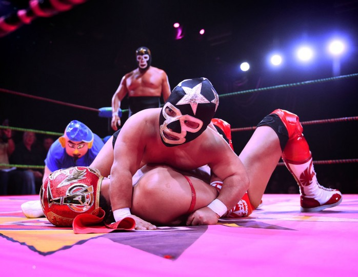 "Wrestlers Matt Classic Jr pins down opponent Cacao during the Lucha Va Voom's ""Crazy in Love"" show at the Mayan Theatre in downtown Los Angeles, California on February 10, 2016. (MARK RALSTON/AFP/Getty Images)"