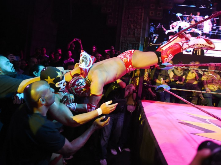 "Wrestlers Matt Classic (left) is hit by a opponent Cacao (right) during the Lucha Va Voom's ""Crazy in Love"" show at the Mayan Theatre in downtown Los Angeles, California on February 10, 2016. (MARK RALSTON/AFP/Getty Images)"