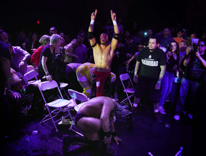 "Wrestler Rey Horus celebrates over his opponent during the Lucha Va Voom's ""Crazy in Love"" show at the Mayan Theatre in downtown Los Angeles, California on February 10, 2016. (MARK RALSTON/AFP/Getty Images)"