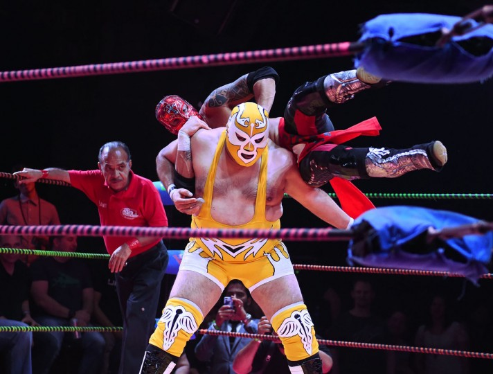 "Wrestler Dr Maldad spins opponent Rey Horus during the Lucha Va Voom's ""Crazy in Love"" show at the Mayan Theatre in downtown Los Angeles, California on February 10, 2016. (MARK RALSTON/AFP/Getty Images)"