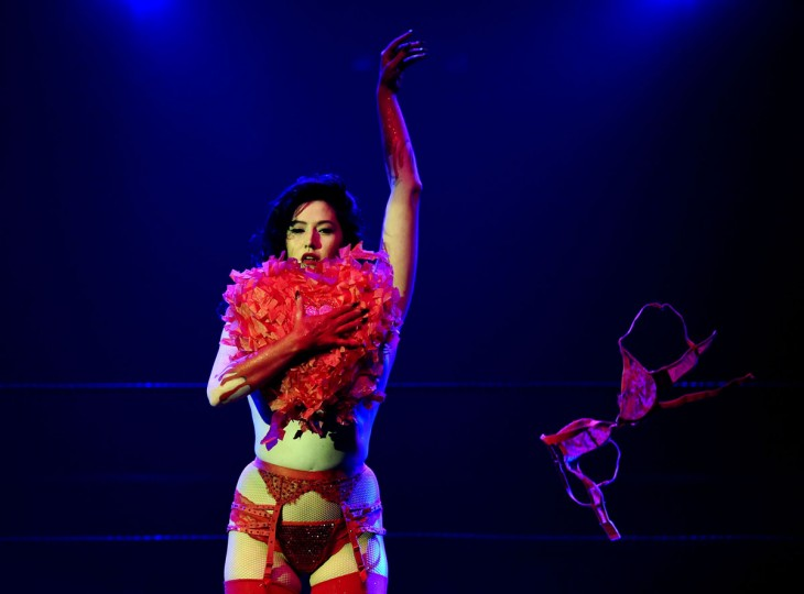 "Striptease artist Molly D'Armour performs for the audience during the Lucha Va Voom's ""Crazy in Love"" show at the Mayan Theatre in downtown Los Angeles, California on February 10. (MARK RALSTON/AFP/Getty Images)"