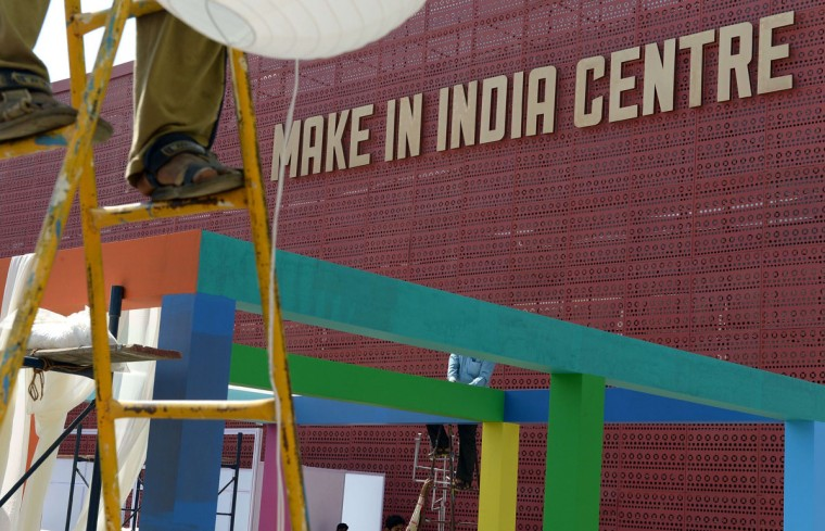 Workers set up stalls at the venue for the 'Make in India' showcase week in Mumbai on February 11, 2016. (INDRANIL MUKHERJEE/AFP/Getty Images)