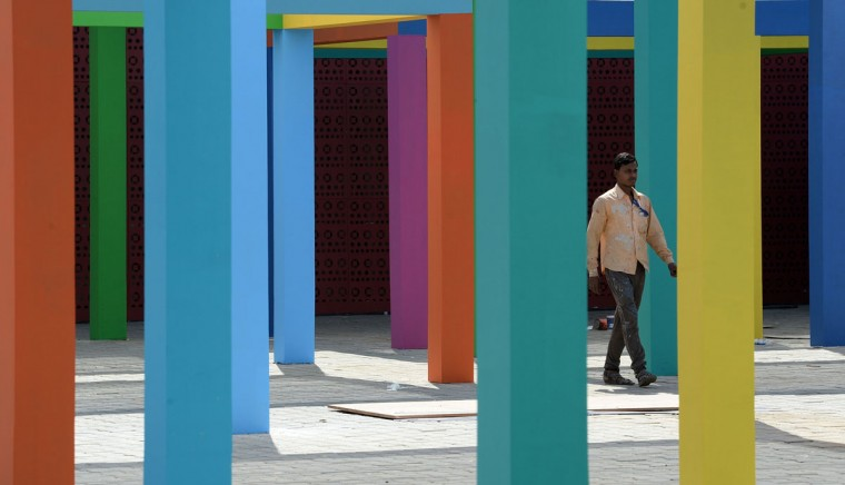 A laborer walks past an installation at the venue for the 'Make in India' showcase week in Mumbai on February 11, 2016. (INDRANIL MUKHERJEE/AFP/Getty Images)