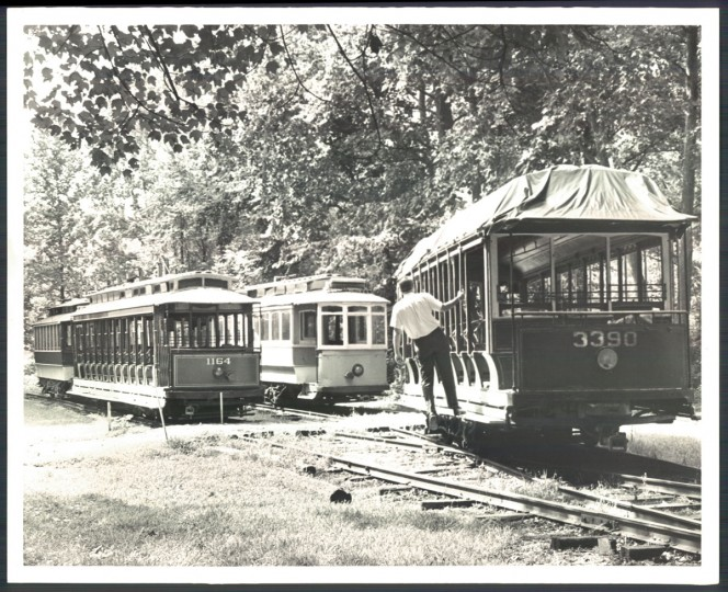 "The city's streetcar buffs say these trolleys in Roland Park need a roof - -a ""living museum"" -- to honor the time when people paid 5 cents or less to ride them. (Baltimore Sun photo, August 4, 1964)"