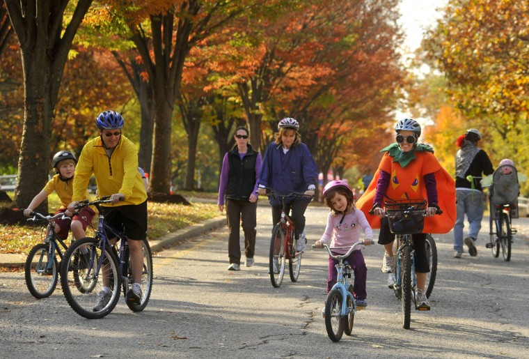 Avery Goldstein, 6, of Roland Park, in front, leads a cluster of riders, including Lynn Heller, also of Roland Park, in a pumpkin costume, at right. Cyclists, walkers, joggers, kids on scooters, and pets came out for Roland Park's second Ciclovia event, in which the southbound lane of Roland Avenue was closed between Northern Parkway and Cold Spring Lane from 8a.m. until 1p.m. on Oct. 31, 2010. (Amy Davis, Baltimore Sun)