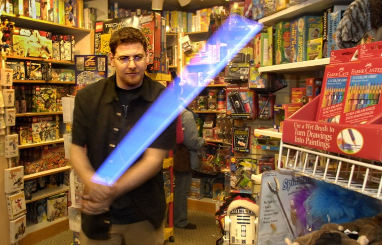 David Stelzer wields a Force FX Light Saber, at his family's store, Shananigans Toy Shop in Roland Park on November 23, 2007. (Baltimore Sun photo by Amy Davis)