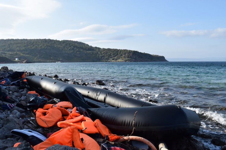 "$1,500 can buy a seat on a rubber dinghy like the one above. With anywhere from 45 to 55 refugees on board, the boats frequently sink. ""Everyone knows the crossing is dangerous,"" Harvey says. But it doesn't keep them from coming. During the day, Harvey's team spent much of their time cleaning up debris from the arrivals. ""I'm a construction worker by trade,"" Harvey says, and his skills came in handy during the cleanup. In some areas there might be a foot or two of deflated boats and life jackets. (Ryan Harvery)"