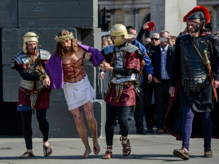 Actor James Burke-Dunsmore is brought out to carry a crucifix whilst playing Jesus during The Wintershall's 'The Passion of Jesus' in front of crowds on Good Friday at Trafalgar Square on March 25, 2016 in London, England. The Wintershall's theatrical production of 'The Passion of Jesus' includes a cast of 100 actors, horses, a donkey and authentic costumes of Roman soldiers in the 12th Legion of the Roman Army. Good Friday is a Christian religious holiday before Easter Sunday, which commemorates the crucifixion of Jesus Christ on the cross. (Photo by Chris Ratcliffe/Getty Images)