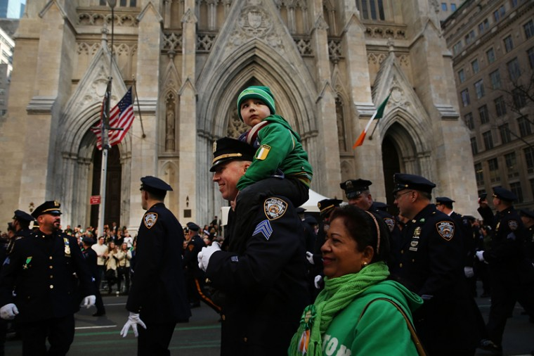 Police officer Sgt. Slavin marches with his son in the annual St. Patrick's Day parade, one of the largest and oldest in the world, on Thursday in New York City. (Spencer Platt/Getty Images)