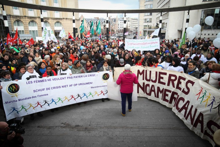 "People hold a banner which translates as ""Women don't want to pay for the crisis"" during the World March of Women 2016 in Brussels on March 8, 2016 as part of the International Women's Day. This year's edition of the international feminist campaign is demanding quality shelter for female asylum seekers. (Virginie Lefour/AFP/Getty Images)"