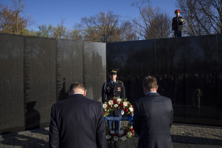 U.S. Secretary of Veterans Affairs Robert McDonald (L) and U.S. Secretary of Defense Ash Carter bow their heads during a wreath laying ceremony to commemorate the 50th anniversary of the Vietnam War at the Vietnam Veterans Memorial March 29, 2016 in Washington, DC. In 2012, President Barack Obama signed a presidential proclamation declaring March 29 Vietnam Veterans Day. (Photo by Drew Angerer/Getty Images)