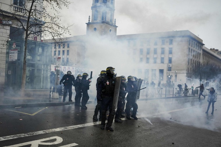 Police clash with protesters during a demonstration on March 9, 2016, in Lyon, central-eastern France, as part of a nationwide day of protest against proposed labour reforms. France faced a wave of protests on March 9 against deeply unpopular labour reforms that have divided an already-fractured Socialist government and raised hackles in a country accustomed to iron-clad job security. (AFP / Jean-Philippe Ksiazek)