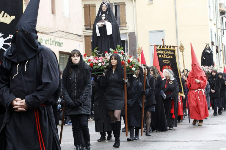 Penitents parade as they carry statues of saints during the Sanch procession that celebrates its 600's birthday on March 25, 2016 in Perpignan. As every Good Friday since 1416, the religious procession of la Sanch traverse takes place in the streets of the French city Perpignan to do penance and perpetrate a Catalan cultural tradition that exist for six centuries. Christian believers around the world mark the Holy Week of Easter in celebration of the crucifixion and resurrection of Jesus Christ. (Raymond Roig/AFP/Getty Images)