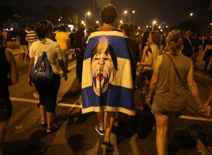 Rolling Stones fans wait for the start of a free concert March 26, 2016 in Havana, Cuba. Thousands of fans waited for the Rolling Stones to play for the first time in Cuba, after the music was once banned by the government. (Joe Raedle/Getty Images)