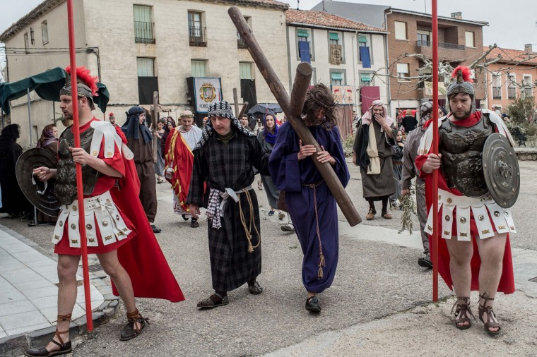 An actor portraying Jesus carries a cross as residents of Hiendelaencia dressed in period clothing perform during the reenactment of Christ's suffering on March 25, 2016 in Hiendelaencina, Spain. The 140 village's residents celebrate every year on Good Friday a reenactment of Christ's suffering before being nailed to the cross Hiendelaencina's inhabitants use their own funds to make the stages and wardrobe. Spain celebrates holy week before Easter with processions in most Spanish towns and villages. (Photo by David Ramos/Getty Images)