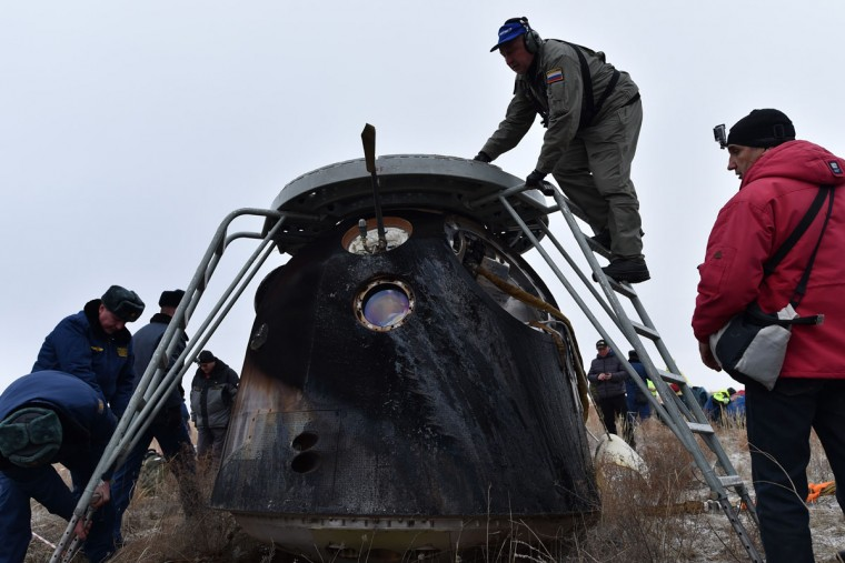 A search and rescue team works at the site of landing of the Soyuz TMA-18M space capsule carrying the International Space Station (ISS) crew of US astronaut Scott Kelly and Russian cosmonauts Mikhail Kornienko and Sergei Volkov outside the town of Dzhezkazgan, Kazakhstan, on March 2, 2016. (KIRILL KUDRYAVTSEV/AFP/Getty Images)