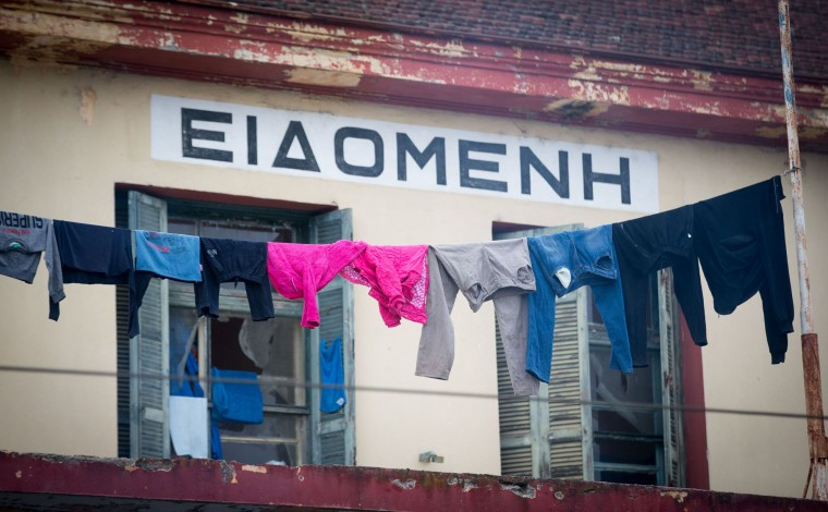 Washing is left out to dry at the railway station at the Idomeni refugee camp on the Greek Macedonia border on March 16, 2016 in Idomeni, Greece. The decision by Macedonia to close its border to migrants last week has left thousands of people stranded at the Greek transit camp. The closure, following the lead taken by neighbouring countries, has effectively sealed the so-called western Balkan route, the main migration route that has been used by hundreds of thousands of migrants to reach countries in western Europe such as Germany. Humanitarian workers have described the conditions at the camp as desperate, which has been made much worse by recent spells of heavy rain. (Photo by Matt Cardy/Getty Images)