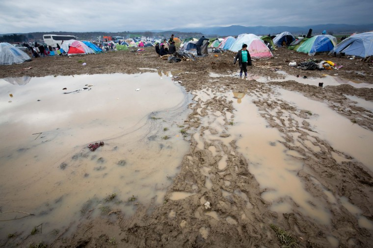 Tents are seen pitched in mud at the Idomeni refugee camp on the Greek Macedonia border on March 16, 2016 in Idomeni, Greece. The decision by Macedonia to close its border to migrants last week has left thousands of people stranded at the Greek transit camp. The closure, following the lead taken by neighbouring countries, has effectively sealed the so-called western Balkan route, the main migration route that has been used by hundreds of thousands of migrants to reach countries in western Europe such as Germany. Humanitarian workers have described the conditions at the camp as desperate, which has been made much worse by recent spells of heavy rain. (Photo by Matt Cardy/Getty Images)