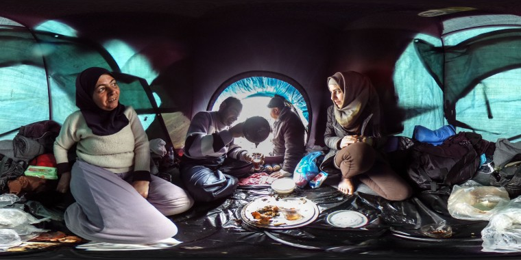 A family drinks tea inside their tent at the Idomeni refugee camp on the Greek Macedonia border on March 16, 2016 in Idomeni, Greece. The decision by Macedonia to close its border to migrants last week has left thousands of people stranded at the Greek transit camp. The closure, following the lead taken by neighbouring countries, has effectively sealed the so-called western Balkan route, the main migration route that has been used by hundreds of thousands of migrants to reach countries in western Europe such as Germany. Humanitarian workers have described the conditions at the camp as desperate, which has been made much worse by recent spells of heavy rain. (Photo by Matt Cardy/Getty Images)