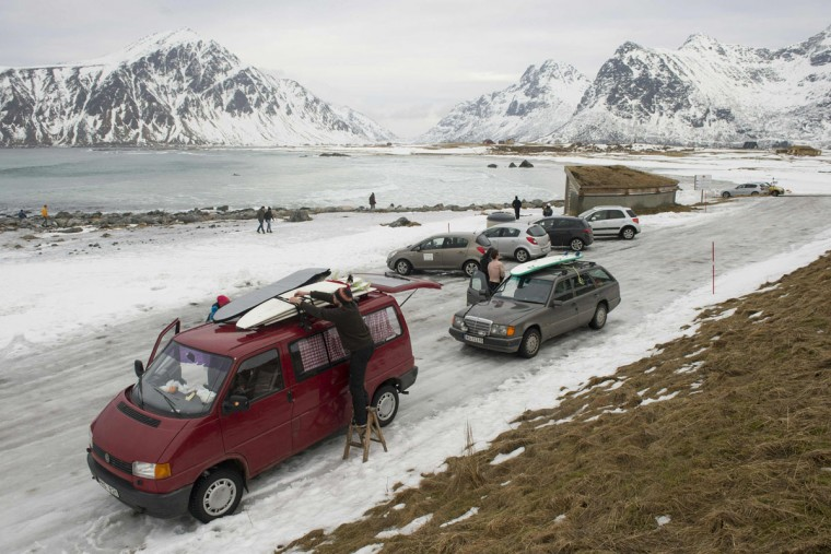 People arrive to go surfing at the snowy beach of Flackstad, near Ramberg, in Lofoten archipelago, Arctic Circle, on March 13, 2016. (OLIVIER MORIN/AFP/Getty Images)