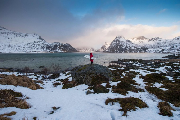 A man looks for a remote surfing spot in a fjord near Flakstad, near Ramberg, in Lofoten archipelago, Arctic Circle, on March 14, 2016. (OLIVIER MORIN/AFP/Getty Images)