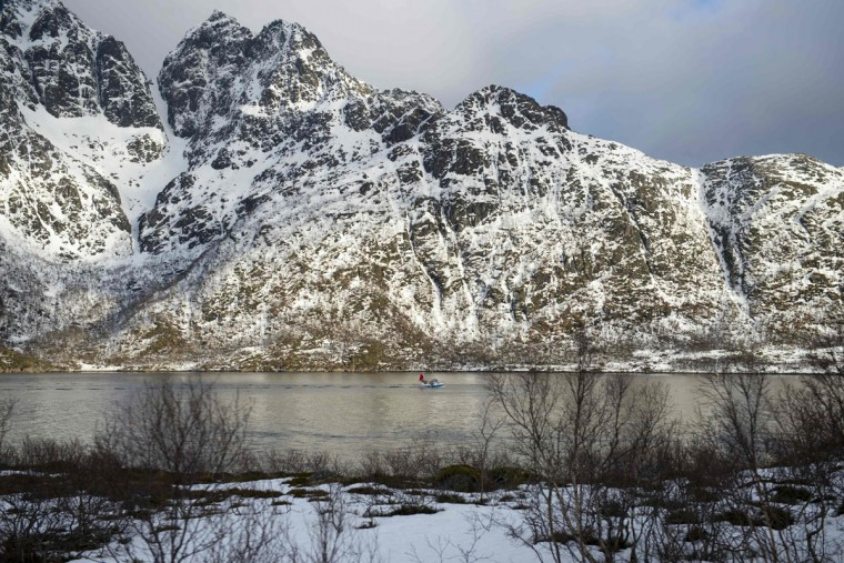 A fishing boat leaves a fjord near Svolvaer, in Lofoten archipelago, Arctic Circle, on March 12, 2016. (OLIVIER MORIN/AFP/Getty Images)