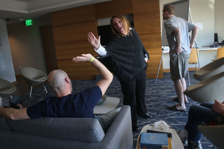 "WESTBOROUGH, MA - MARCH 22: A rehab counselor ""high-fives"" an addict in recovery following a group therapy session at a substance abuse treatment center on March 22, 2016 in Westborough, MA. The new 100-bed residential rehab center, run by Spectrum Health Systems, is expanding staff, as communities across New England are struggling with the unprecidented heroin and opioid pain pill epidemic. On March 15, the U.S. Centers for Disease Control (CDC), announced guidelines for doctors to reduce the amount of opioid painkillers prescribed nationwide, in an effort to curb the epidemic. The CDC estimates that most new heroin addicts first became hooked on prescription pain medication before graduating to heroin, which is stronger and cheaper. (John Moore/Getty Images)"