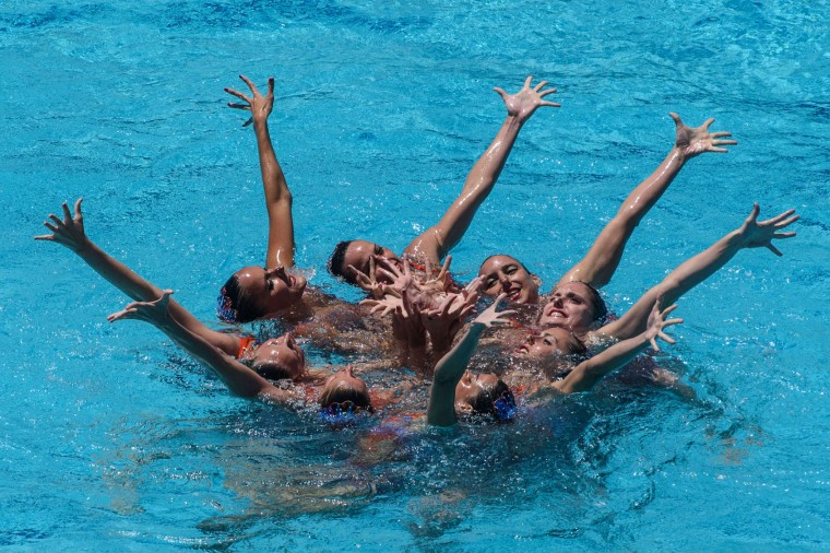 The synchronized swimming team of Spain performs during the teams' free routine final of the FINA Synchronized Swimming Olympic Games Qualification Tournament at the Maria Lenk Aquatic Centre in Rio de Janeiro, Brazil, on March 6, 2016. (Yasuyoshi Chiba/AFP/Getty Images)
