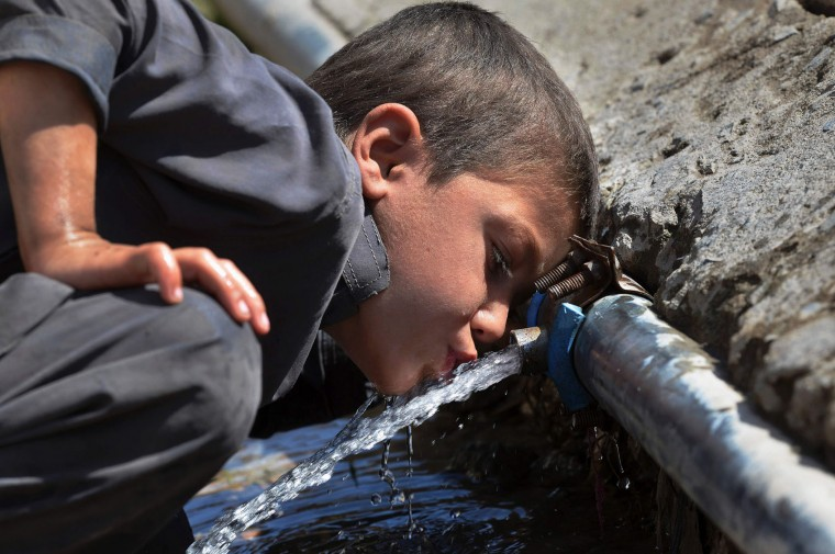 A Pakistani child drinks water from a pipe in a makeshift settlement in Peshawar on March 22, 2016. International World Water Day is held annually on March 22 to focus global attention on the importance of water and advocate for sustainable water resource management. (A Majeed/AFP/Getty Images)
