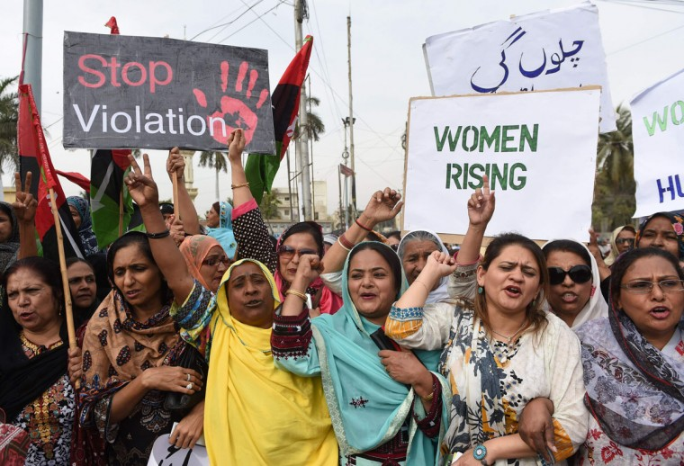 Activists of The Pakistan People's Party (PPP) hold placards as they march during a rally to mark International Women's Day in Karachi on March 8, 2016. Women in conservative Pakistan have fought for their rights for decades, in a country where so-called honor killings and acid attacks remain commonplace. (Asif Hassan/AFP/Getty Images)