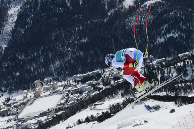 Switzerland's Beat Feuz jumps during the men's downhill practice at the FIS Alpine Skiing World Cup finals on March 15, 2016 in St. Moritz. (Fabrice Coffrini/AFP/Getty Images)