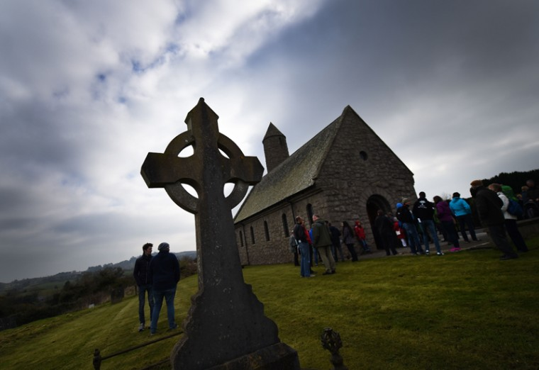 The annual Saint Patrick's Day pilgrimage from Saul church to Downpatrick cathedral takes place on Thursay in Downpatrick, Northern Ireland. Saint Patrick, who converted Ireland to Christianity, is celebrated as the patron saint of Ireland on the 17th of March, St. Patrick's Day, which is said to be the date of his death in the early part of the fifth century. The service and 2-mile pilgrimage from Saul to Saint Patrick's resting place charts his arrival in Ireland at Saul.   (Charles McQuillan/Getty Images)