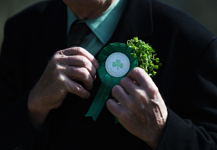 A church goer adjusts his shamrock during the annual Saint Patrick's Day service and pilgrimage from Saul church to Downpatrick cathedral on Thursday in Downpatrick, Northern Ireland. (Charles McQuillan/Getty Images)