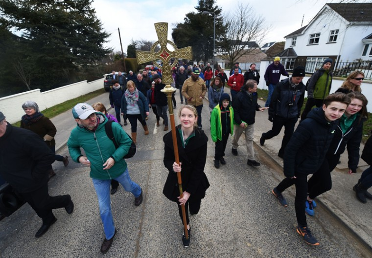 Church goers take turns in carrying the a staff representing Saint Patrick during the annual Saint Patrick's Day service and pilgrimage from Saul church to Downpatrick cathedral on Thursday in Downpatrick, Northern Ireland. (Charles McQuillan/Getty Images)