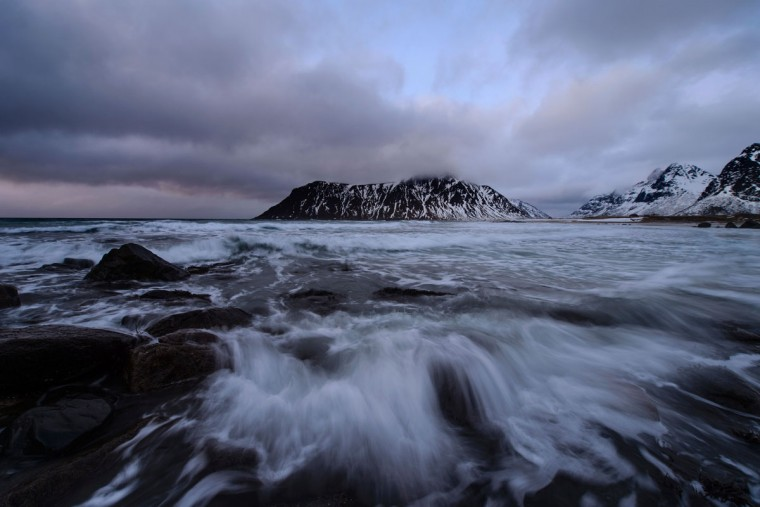 Water goes over the rocks near the beach in Flakstad, near Ramberg, in Lofoten archipelago, Arctic Circle, on March 12, 2016. (OLIVIER MORIN/AFP/Getty Images)