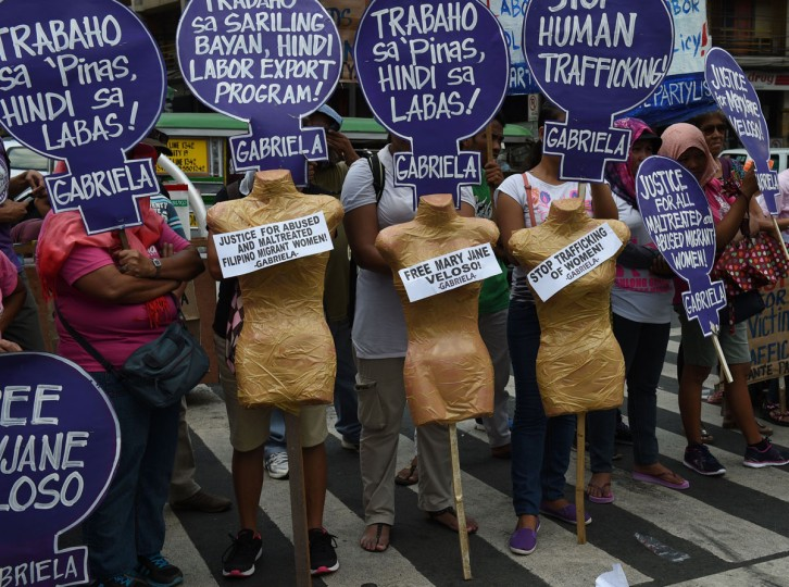 Members of Gabriela women's group along with Migrant workers' union display placards and cut-out mannequins during a rally to celebrate International Women's Day near Malacanang palace in Manila on March 8, 2016. Dozens of women joined the rally and assailed the government of its export labour policy citing the case of Filipina worker Mary Jane Veloso, a convicted drug mule but given reprieved by the Indonesian government last April 29, 2015. (Ted Aljibe/AFP/Getty Images)