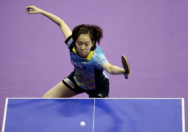 Kasumi Ishikawa of Japan hits a return against Kristin Silbereisen of Germany during their women's singles round match of the 2016 World Team Table Tennis Championships at the Malawati Stadium in Shah Alam on Wednesday. (MANAN VATSYAYANA/AFP/Getty Images)