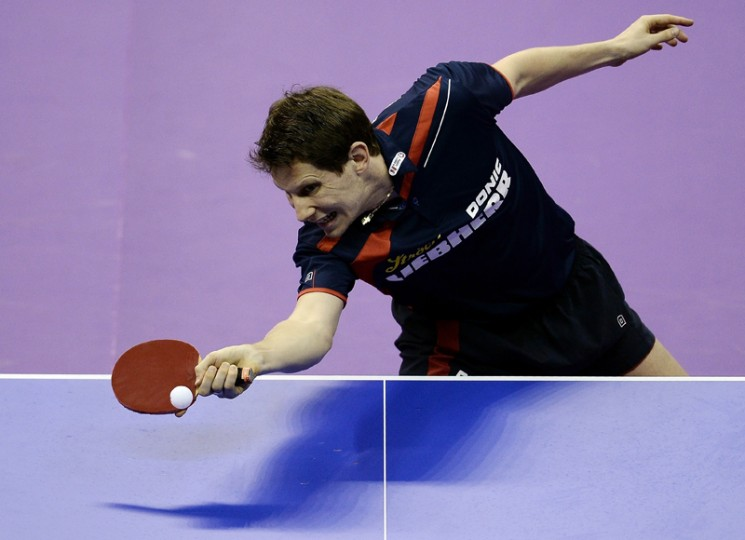 Robert Gardos of Austria hits a return against Ma Long of China during their men's singles round match of the 2016 World Team Table Tennis Championships at the Malawati Stadium in Shah Alam on Wednesday. (MANAN VATSYAYANA/AFP/Getty Images)