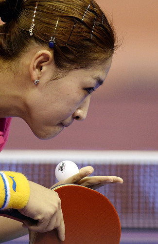 Liu Shiwen of China serves against Cheng Hsien-Tzu of Taiwan during their women's singles round match of the 2016 World Team Table Tennis Championships at the Malawati Stadium in Shah Alam on Wednesday. (MANAN VATSYAYANA/AFP/Getty Images)