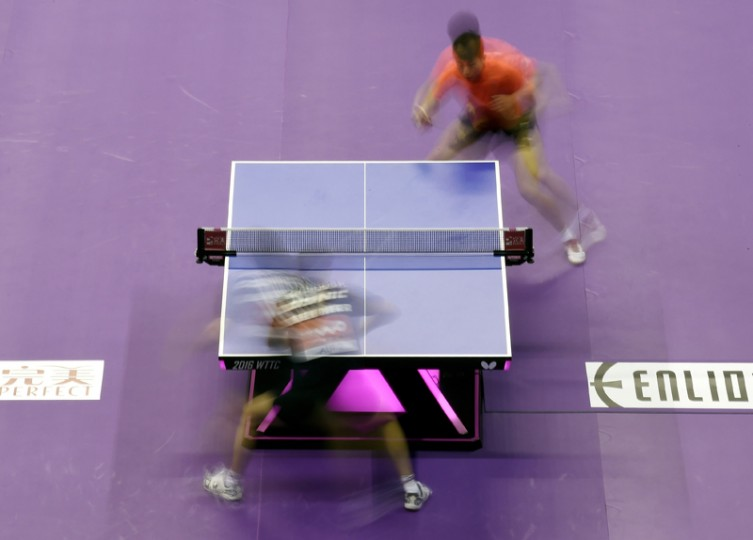Ma Long of China ( top, R) and Robert Gardos of Austria (bottom, L) compete during their men's singles round match of the 2016 World Team Table Tennis Championships at the Malawati Stadium in Shah Alam, Malaysia on Wednesday. (MANAN VATSYAYANA/AFP/Getty Images)