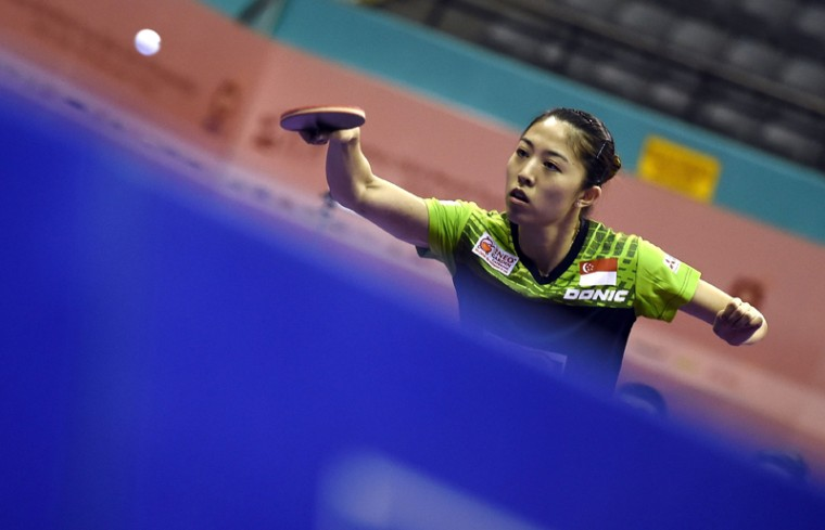 Yu Mengyu of Singapore hits a return against Li Jie of Netherlands during their women's singles round match of the 2016 World Team Table Tennis Championships at the Malawati Stadium in Shah Alam on Wednesday. (AMANAN VATSYAYANA/AFP/Getty Images)
