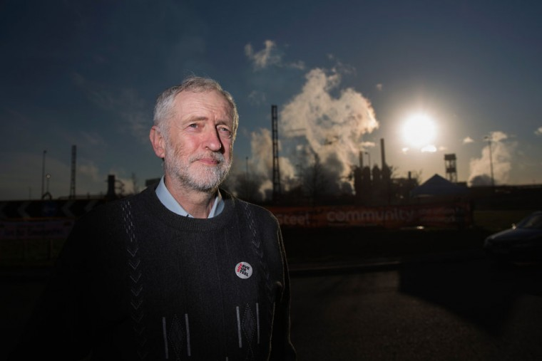 Labour leader Jeremy Corbyn poses for the media outside the Tata Steel plant on March 30, 2016 in Port Talbot, Wales. Indian owners Tata Steel put its British business up for sale yesterday, placing thousands of jobs at risk and hitting the already floundering UK steel industry. (Photo by Christopher Furlong/Getty Images)