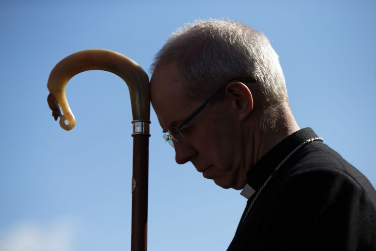 The Arch-Bishop of Canterbury listens to a service after a March of Witness through the town centre on March 25, 2016 in Sittingbourne, England. Christians around the world have observed religious services to mark Good Friday. The holiday is observed during Holy Week as part of the Paschal Triduum on the Friday preceding Easter Sunday. (Photo by Carl Court/Getty Images)