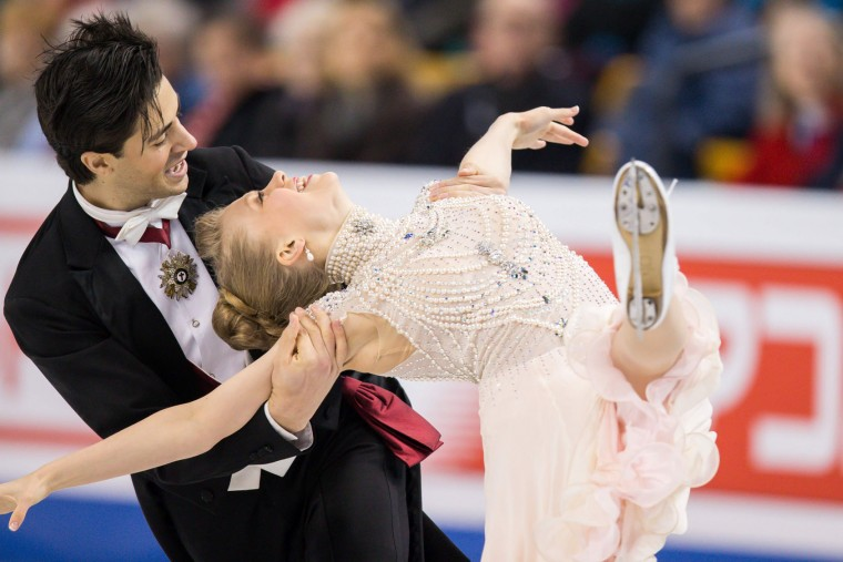 Kaitlyn Weaver and Andrew Poje of Canada skate during the Ice Dance short dance at the ISU World Figure Skating Championships at TD Garden in Boston, Massachusetts, March 30, 2016. (Geoff Robins/AFP/Getty Images)