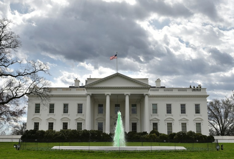 The fountain on the North Lawn of the White House is colored green in celebration of Saint Patrick's Day on Thursday in Washington, DC. (MANDEL NGAN/AFP/Getty Images)