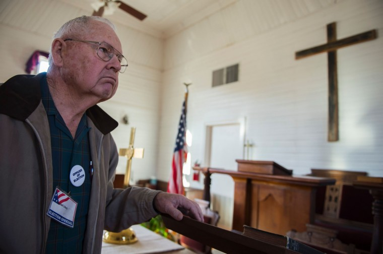 An election official walks through Graves chapel, used as a county voting location, in Graves Mill, Virginia on March 1, 2016, during the Super Tuesday primary voting. Americans began voting in the crucial Super Tuesday primaries and caucuses in what is deemed the most critical day in the presidential nominating process. (Andrew Caballero-Reynolds/AFP/Getty Images)