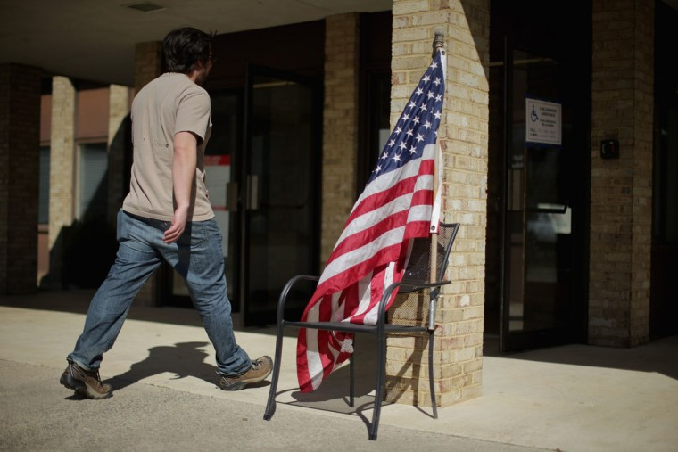 A U.S. flag taped to a chair stands at the entry of the Fairfax Circle Baptist Church to indicate a polling place during Super Tuesday voting March 1, 2016 in Fairfax, United States. Officials are expecting a record turn out of voters in Virginia, one of a dozen states holding presidential primaries or caucuses. (Photo by Chip Somodevilla/Getty Images)